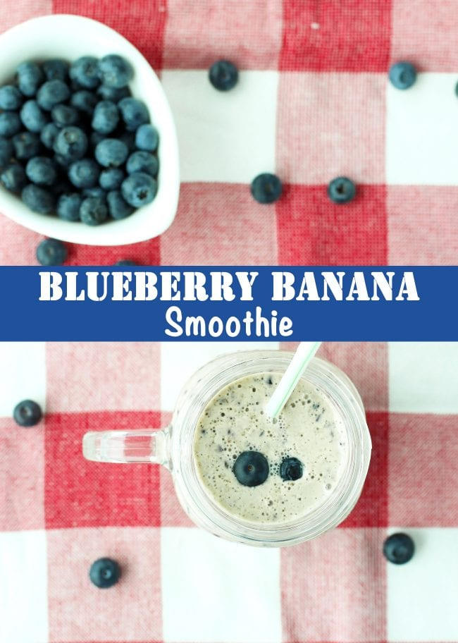 Blueberry banana smoothie in a mason jar mug with a straw and a small white dish with blueberries behind the mug. Blueberry are scattered around the mug.