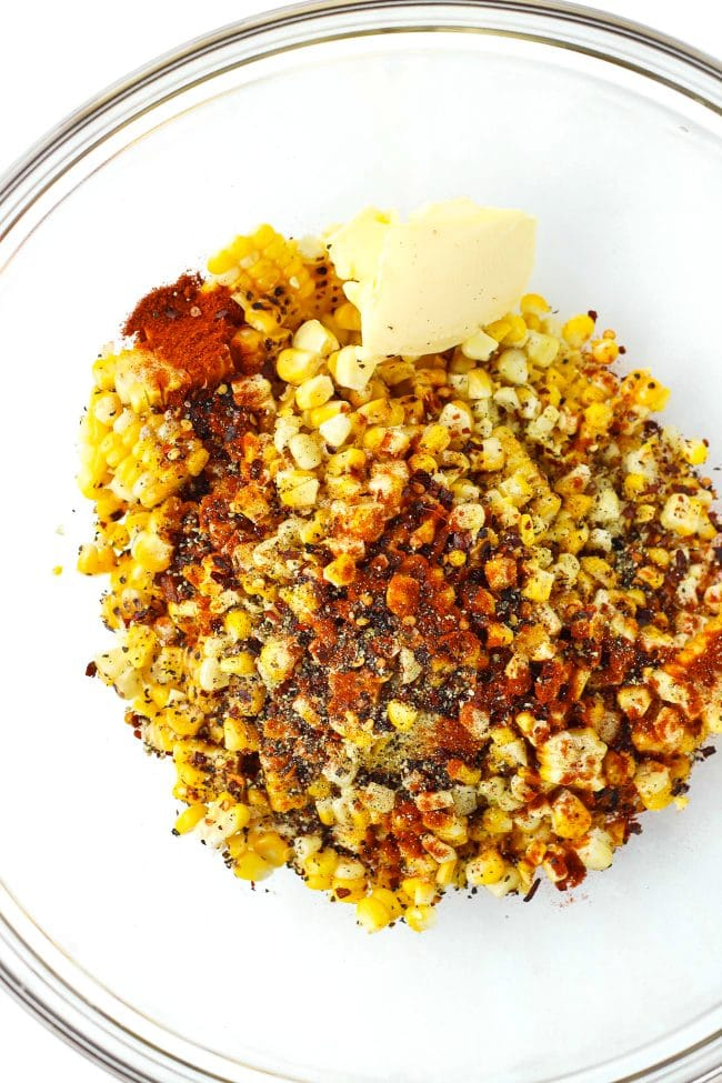 Corn kernals, butter, spices and seasonings in a large mixing bowl.