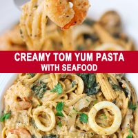 Fork with piece of shrimp at the tip and Creamy Tom Yum Pasta in plate