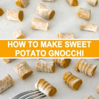 Sweet Potato Gnocchi piece on the tines of the back of a fork with gnocchi pieces scattered around.
