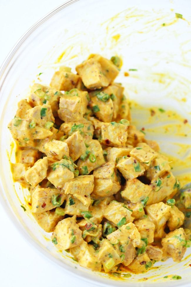 Spicy mango Mayonnaise, diced chicken, chopped coriander, chopped spring onion tossed together in a mixing bowl.