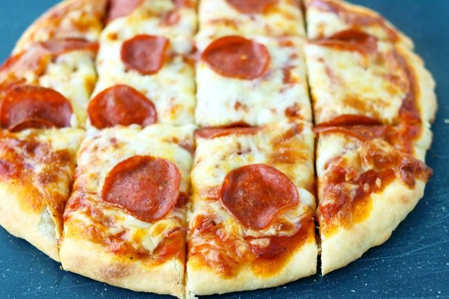 Front view of a pepperoni pizza cut into squares.