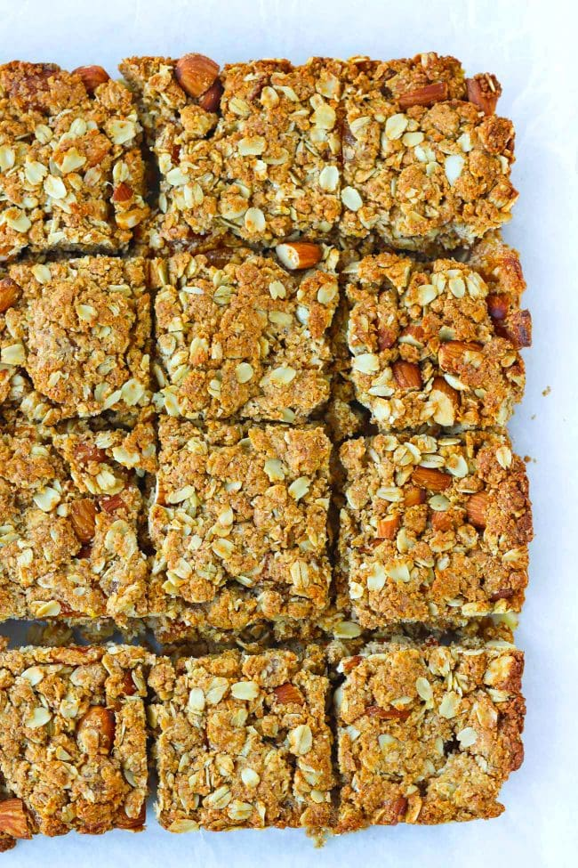 Apricot and almond oat slices on parchment paper.