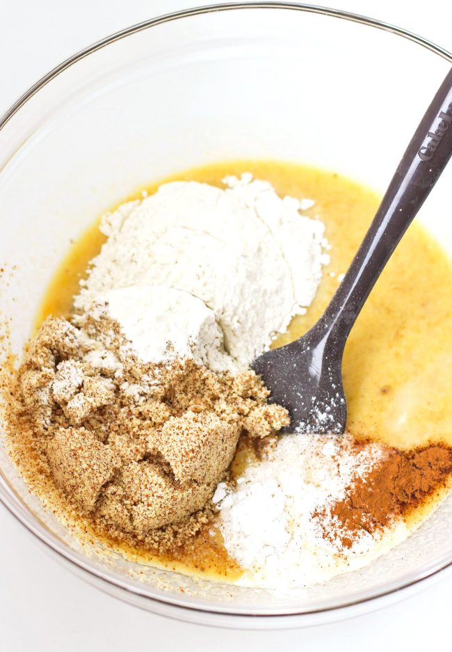 Flour, ground almonds, baking powder, baking soda, ground cinnamon in a large mixing bowl with mixed mashed bananas and eggs.
