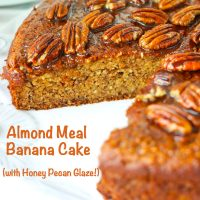 Almond Meal Banana Cake with honey pecan glaze on a large round plate with a slice cut out to show the inside texture.