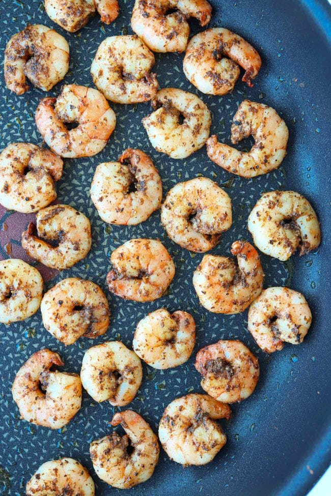 Seasoned pan-seared shrimp in a large skillet.