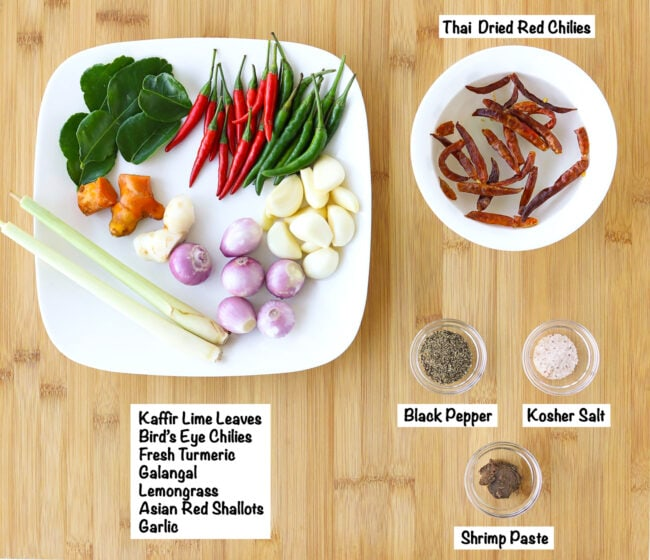 Labeled ingredients for Southern Thai Curry Paste on wooden board.