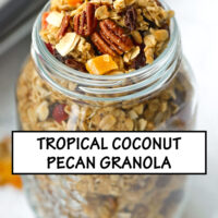 """Tilted top view of mason jar with granola. Text overlay """"Tropical Pecan Coconut Granola"""", and """"Easy - Customizable - Refined Sugar Free""""."""