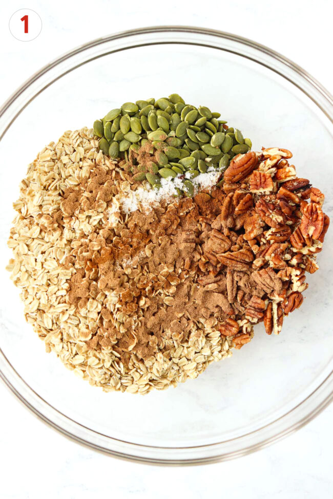 Oats, pecans, pumpkin seeds, salt, ground cinnamon, and pumpkin pie spice in a large mixing bowl.