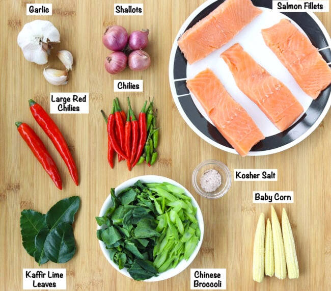 Fresh ingredients for Choo Chee Salmon Curry on wooden board.