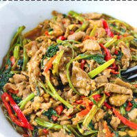 """Front view of bowl with lamb and veggies stir-fry. Text overlay """"Taiwanese Lamb & Water Spinach Stir-fry""""."""