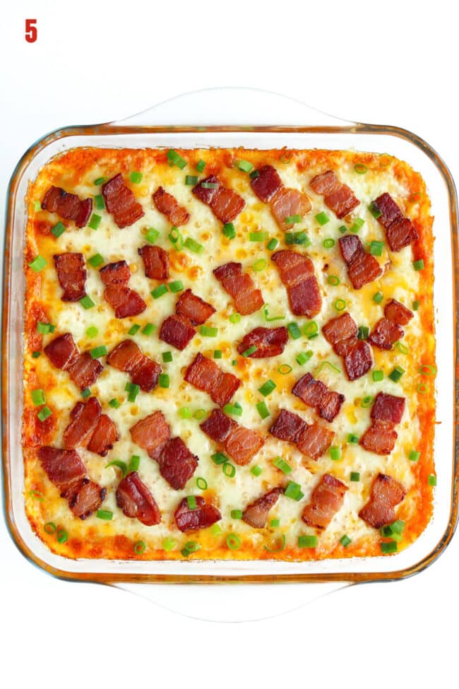 Baked loaded sweet potato casserole in square glass dish topped with fried bacon pieces and spring onion.