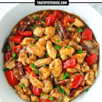 """Top view of bow with a Chinese chicken stir-fry and two bowls with rice behind. Text overlay """" Spicy Pepper Chicken"""" and """"thatspicychick.com""""."""