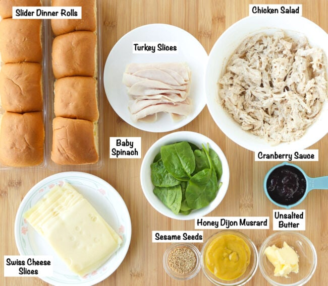 Labeled ingredients for Turkey and Chicken Cranberry Sliders on a wooden board.