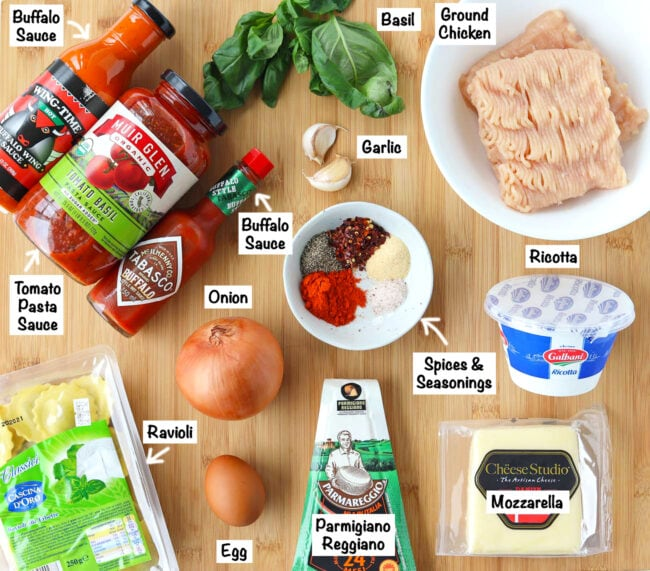 Labeled ingredients for Buffalo Chicken Ravioli Lasagna on a wooden board.