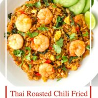 """Top view of a plate with spicy prawn fried rice. Text overlay """"Thai Roasted Chili Fried Rice with Prawns"""" and """"thatspicychick.com""""."""