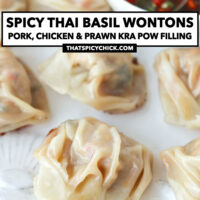 """Close-up front view of plate with wontons and prik nam pla sauce. Text overlay """"Spicy Thai Basil Wontons, Pork, Chicken & Prawn Kra Pow Filling"""" and """"thatspicychick.com""""."""