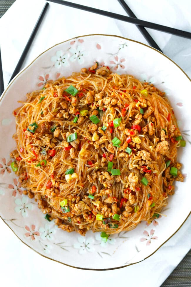 Top view of plate with Ants Climbing A Tree - stir-fried Sichuan glass noodles with ground pork.