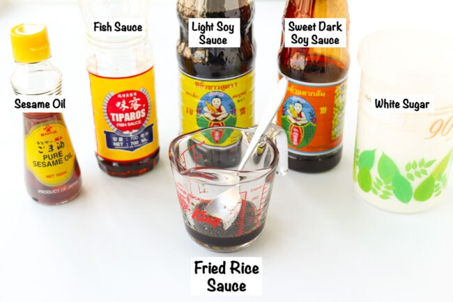 Labeled sauce ingredients for Spicy Thai Pork Fried Rice and sauce in a measuring cup.