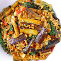Top view of eggplant and ground pork stir-fry in a serving bowl