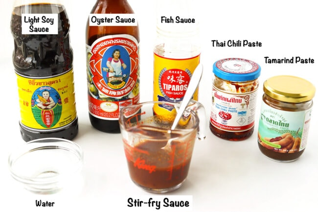 Labeled sauce ingredients for Thai Eggplant Stir-fry on a white table.