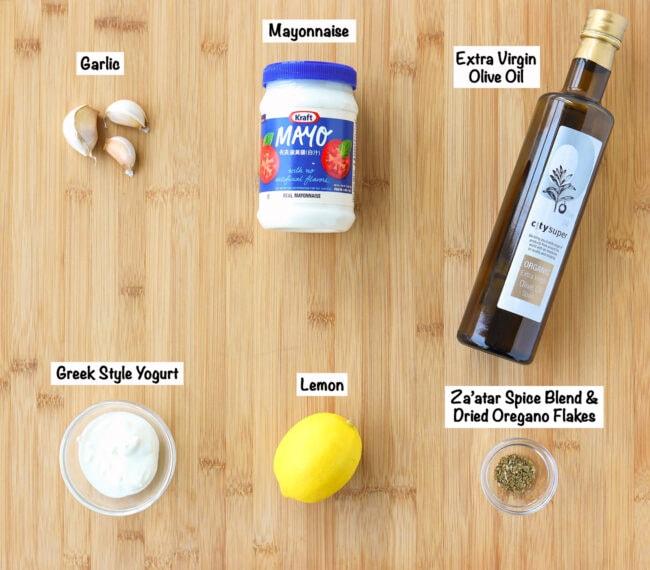Labeled ingredients for Kebab Shop Garlic Sauce on wooden board.