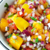 """Front view of bowl with mango salsa. Text overlay """"Fresh Mango Salsa"""", """"Easy 