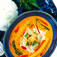 """Chicken curry in small blue bowl. Text overlay """"Thai Panang Chicken Curry"""", """"Quick & Easy 