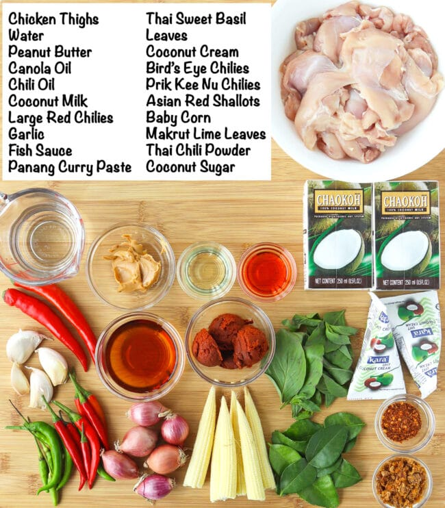 Labeled ingredients for Thai Panang Chicken Curry on wooden board.
