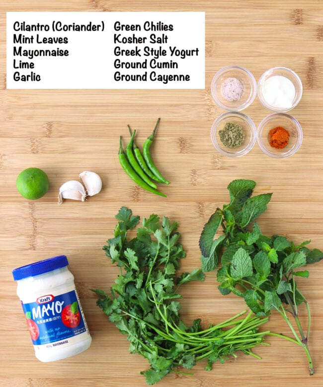 Labeled ingredients for Cilantro and Mint Sauce on a wooden board.
