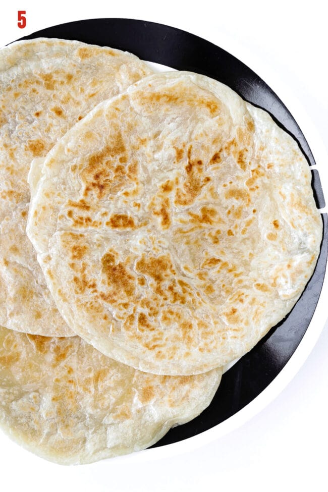 Cooked parathas on a plate.