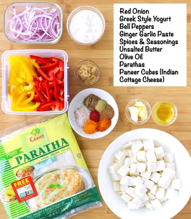 Labeled ingredients for Paneer Tikka Kathi Rolls on a wooden board.