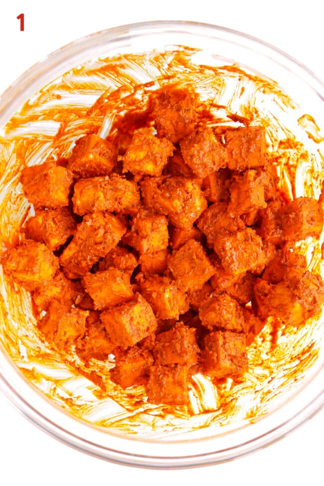 Marinated Indian cottage cheese cubes (paneer) in a mixing bowl.