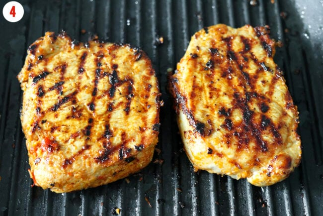 Grilling pork steaks on a grill pan.