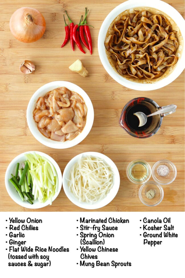 Labeled ingredients for Chicken Chow Fun on a wooden board.