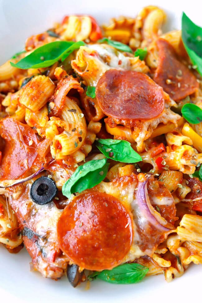 Close-up front view of a serving of pizza pasta on a plate.
