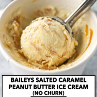 """Ice cream scooper with ice cream in a paper carton. Text overlay """"Baileys Salted Caramel Peanut Butter Ice Cream (No Churn)"""" and """"thatspicychick.com""""."""