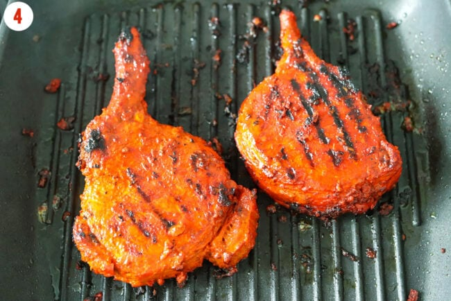 Charred Indian pork cutlets on grill pan.