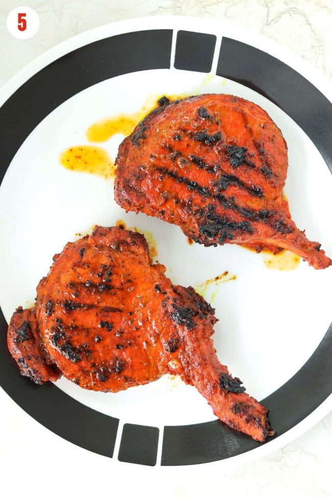 Grilled pork cutlets resting on a plate.