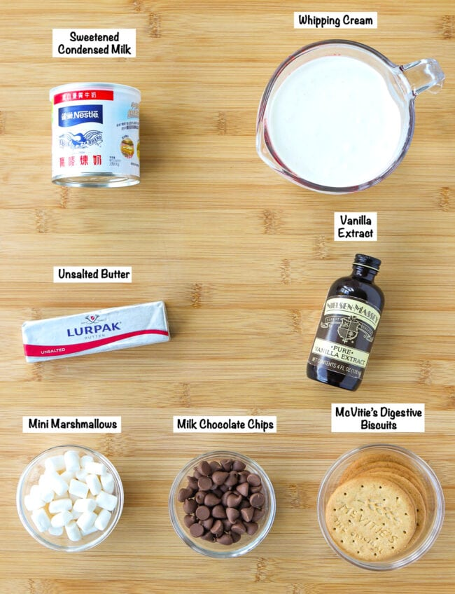 Labeled ingredients for S'mores Ice Cream on a wooden board.