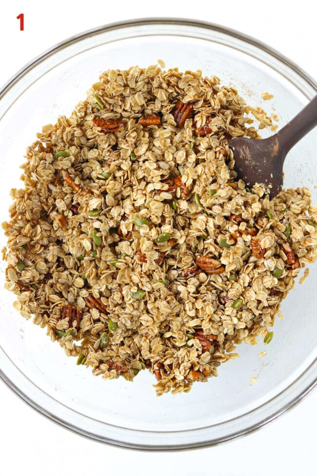 Oats, pecans, seeds, spices, maple syrup, oil, and desiccated coconut tossed together in a mixing bowl.
