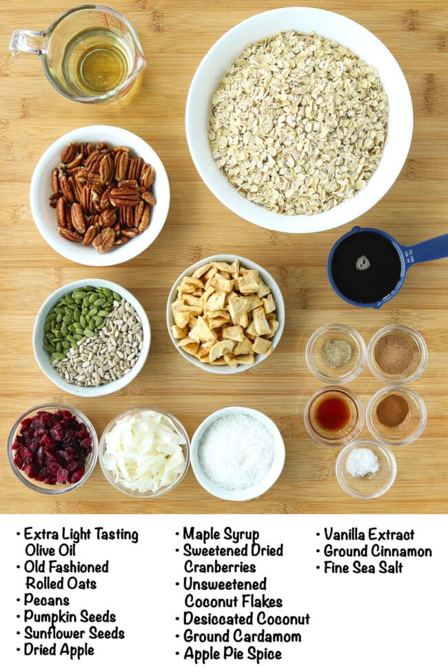Labeled ingredients for Apple Pie Granola on a wooden board.