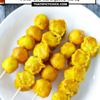 """Close-up front view of fish balls and shu mai skewers on a plate. Text overlay """"Hong Kong Curry Fish Balls and Siu Mai (Shu Mai)"""" and """"thatspicychick.com""""."""