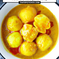 """Close-up of bowl with curry fish balls and siu mai drizzled with chili oil. Text overlay """"Hong Kong Curry Fish Balls and Siu Mai (Shu Mai)"""" and """"thatspicychick.com""""."""