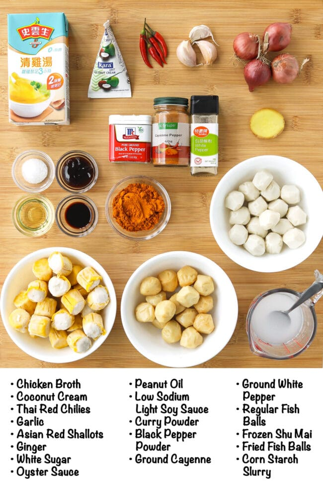Labeled ingredients for Hong Kong Curry Fish Balls on a wooden board.