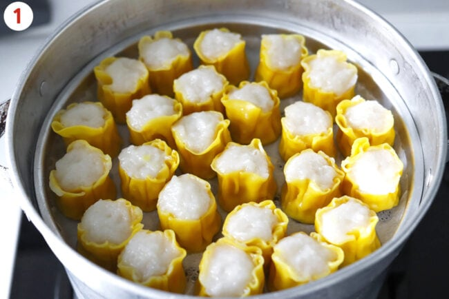 Steamed shu mai in an aluminum steamer on the stovetop.
