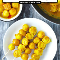 """Top view of plate with siu mai and curry fish balls skewers. Text overlay """"Hong Kong Curry Fish Balls and Siu Mai (Shu Mai)"""" and """"thatspicychick.com""""."""