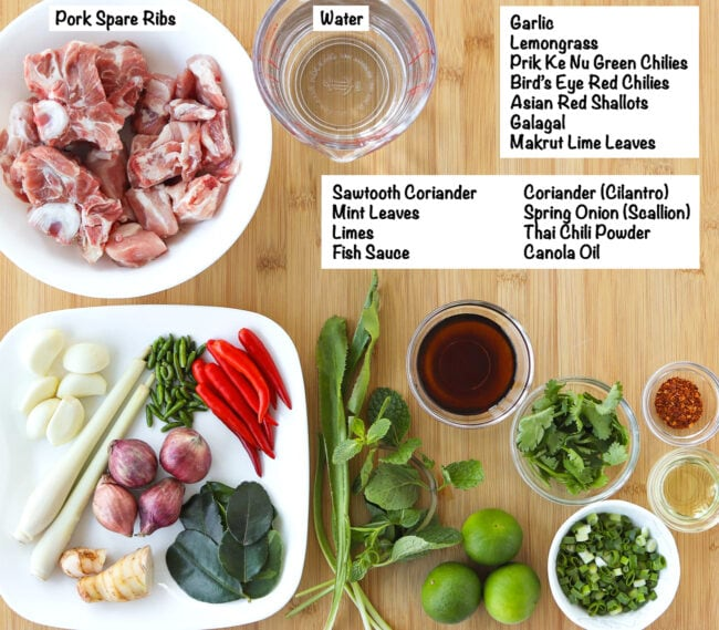 Labeled ingredients for Thai Spicy Pork Rib Soup on a wooden board.